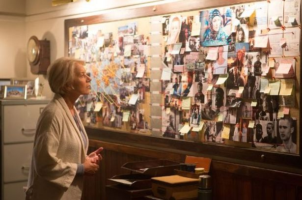 Helen Mirren studies her character profiles and story plot board for her next screenplay