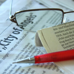 Finding Story Gold Under Your Nose: How to Mine Newspaper Articles for Killer Stories that SELL image